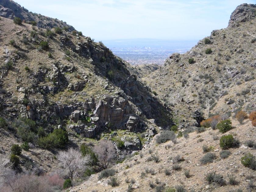 Downtown Albuquerque visible through the mouth of Juan Tabo Canyon.