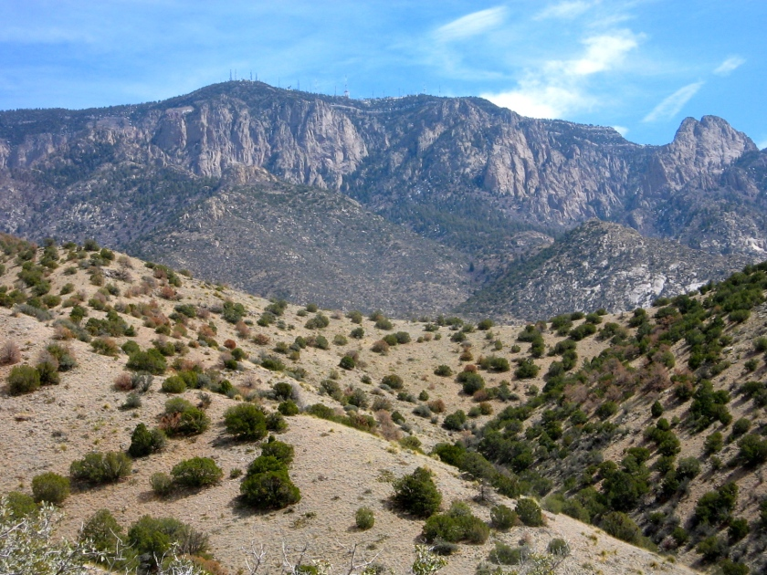 Crest of the Sandia Mountains with radio towers on top.