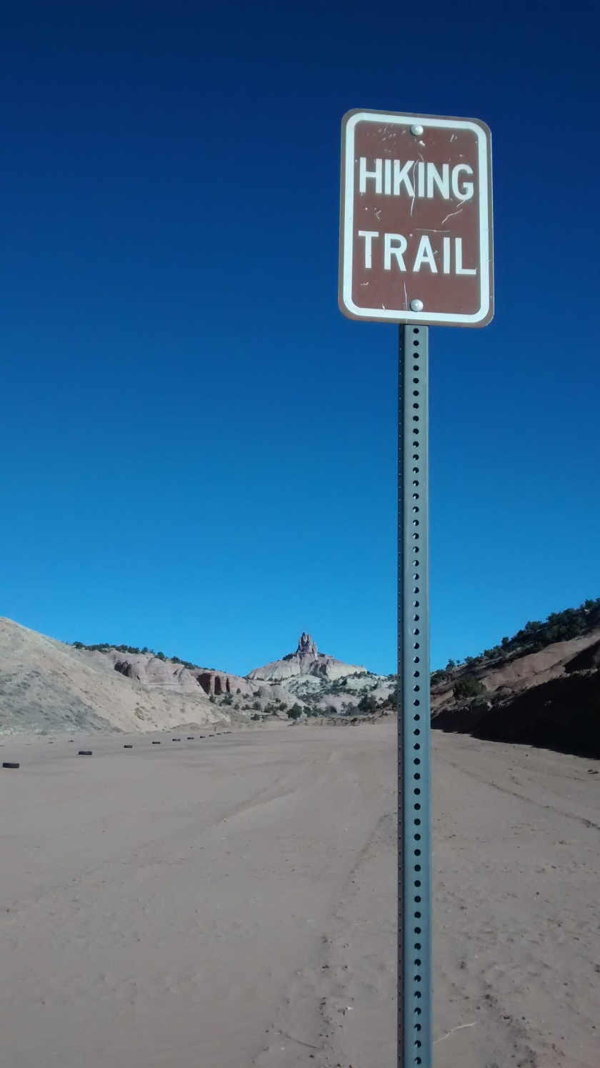 Parking lots and rodeo grounds at Red Rock make for some strange-looking trailheads.
