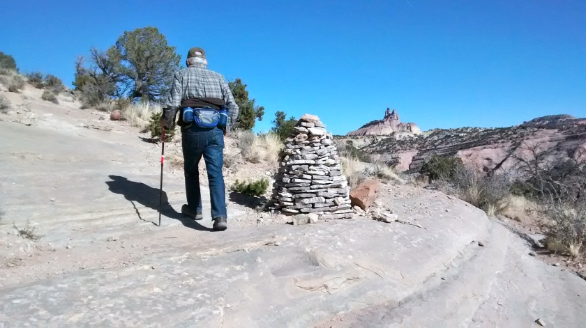 A cairn on the Pyramid Rock Trail with Church Rock to the right.