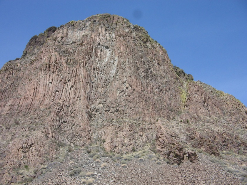 """On the righthand side, marked by a line of green lichen-covered rocks, is the upper trail that ascends through a """"chimney"""" to the summit."""