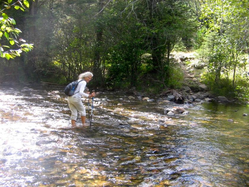 Wading across Rio Mora.