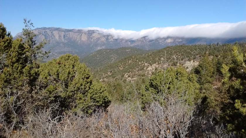 South Sandia Peak shrouded in clouds behind us viewed from Whitewash Trail.
