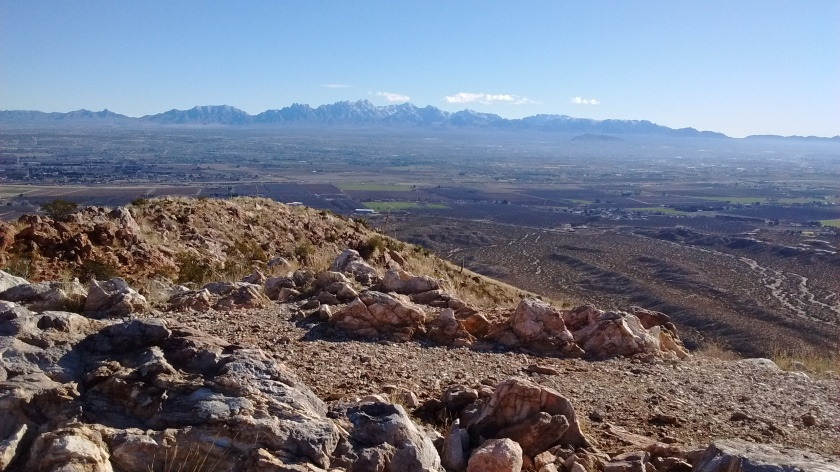 View from the top looking southeast towards Las Cruces. Organ Mountains in the distance.