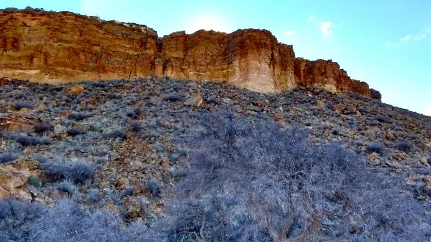 Circling the base of the escarpment.